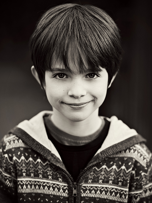 Black and white portrait of a little boy.